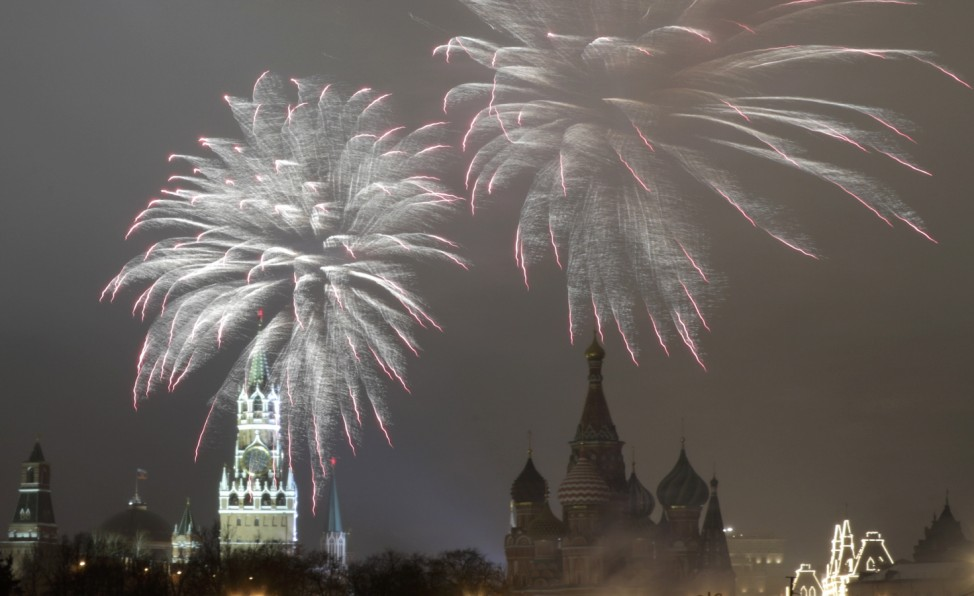 Fireworks light the sky over the Kremlin and St. Basil's Cathedral during the New Year's Day celebrations in central Moscow