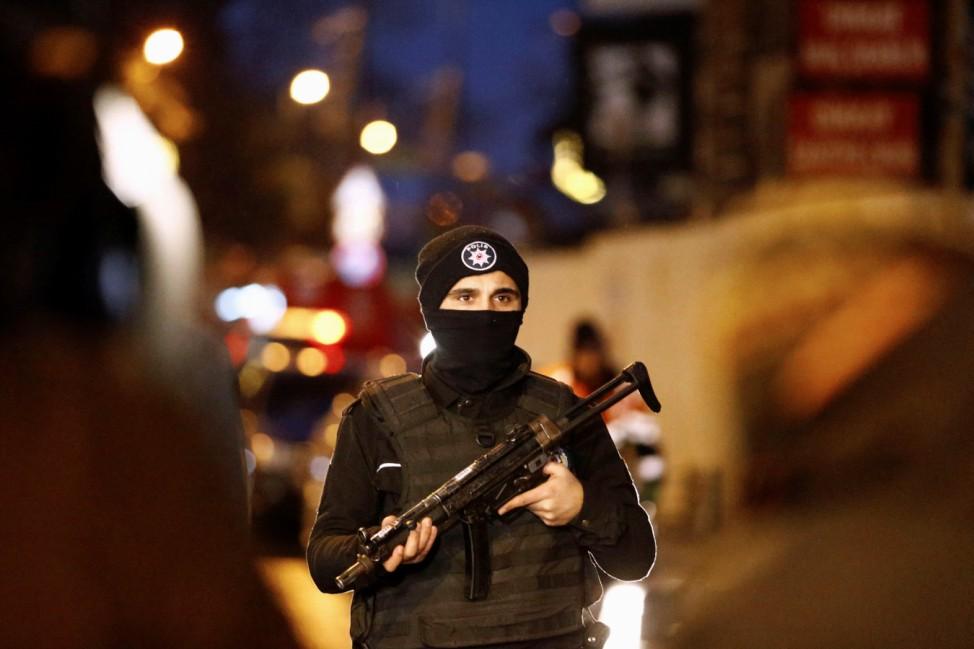 Police secure an area near an Istanbul nightclub, following a gun attack, in Turkey
