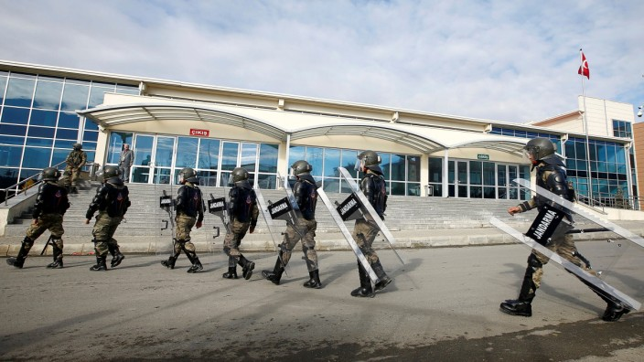 Turkish soldiers walk outside the Silivri Prison and Courthouse complex during the first trial related to Turkey's failed coup, in Istanbul