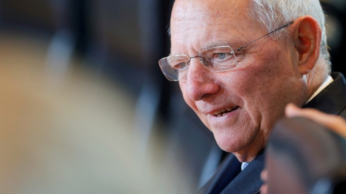 German Finance Minister Schaeuble attends the weekly cabinet meeting at the chancellery in Berlin