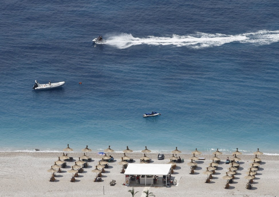 People are seen on a beach in Dhermi near the city of Vlore