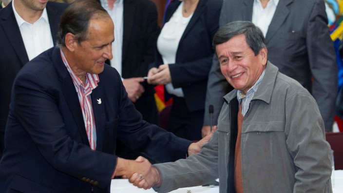 Restrepo Colombia's government representative shakes hands with Beltran representative of the delegation of ELN for formal peace talks with Colombian government after a news conference in Quito