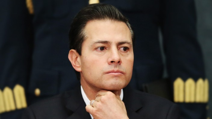 Mexico's President Enrique Pena Nieto gestures as he delivers a message about foreign affairs at Los Pinos presidential residence in Mexico City