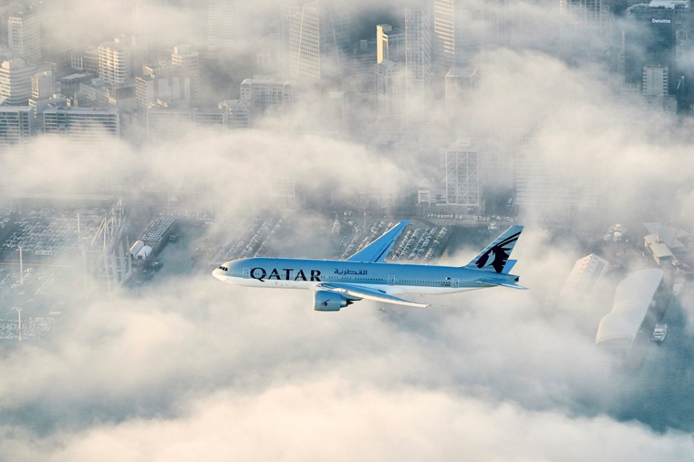 Qatar AirwaysâÄÖ first flight to New Zealand flies over the city of Auckland on its final approach to the airport