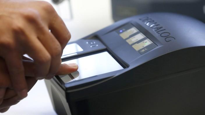 A file photo of the fingerprint of a refugee being taken at the migrants registration center of the Patrick-Henry Village refugee center in Heidelberg