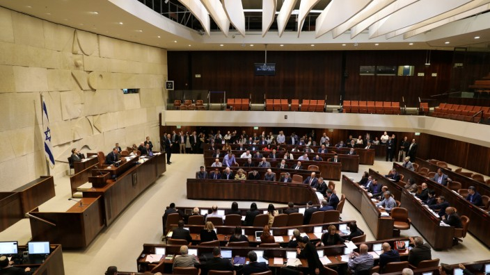 Israeli lawmakers attend a vote on a bill at the Knesset, the Israeli parliament, in Jerusalem