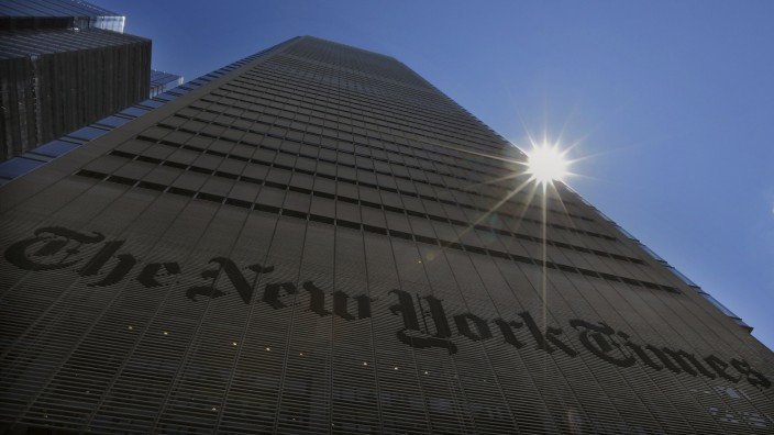 File photo of the sun peaking over the New York Times Building in New York