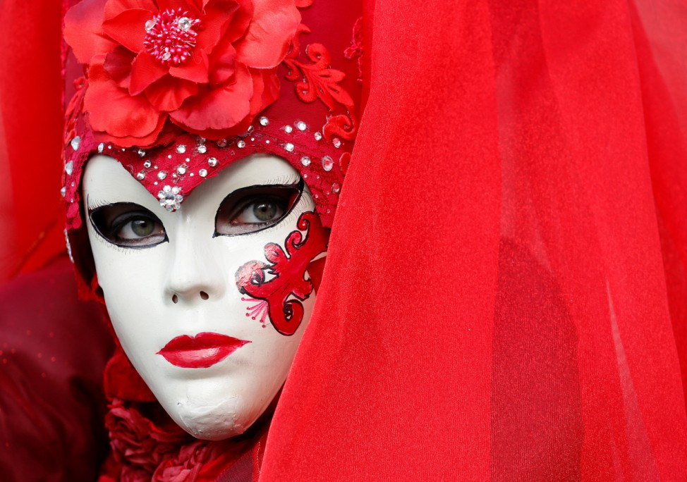 A masked reveller poses during the Venice Carnival in Venice