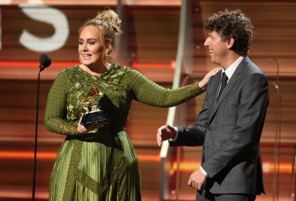 Adele and co-song writer Kurstin accept the Grammy for Song of the Year for 'Hello' at the 59th Annual Grammy Awards in Los Angeles