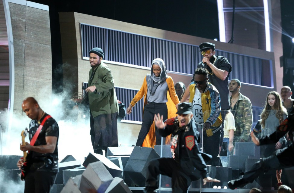 A Tribe Called Quest and Anderson Paak break down a wall during their performance at the 59th Annual Grammy Awards in Los Angeles