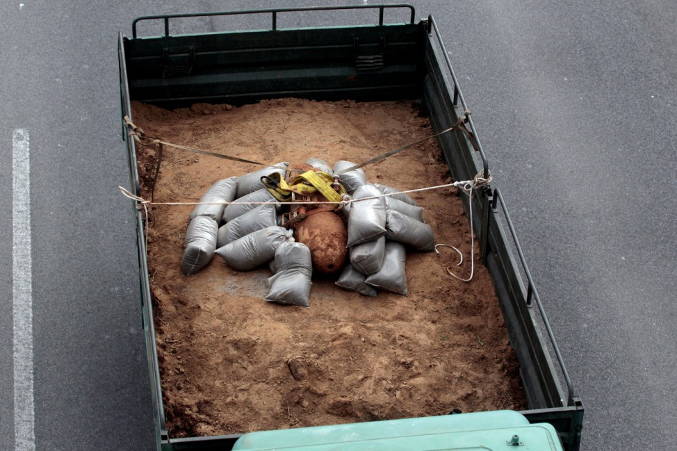 A 250 kg World War Two bomb that was found during excavation works at a gas station, is carried on a military truck, following an operation to defuse it, in the northern city of Thessaloniki
