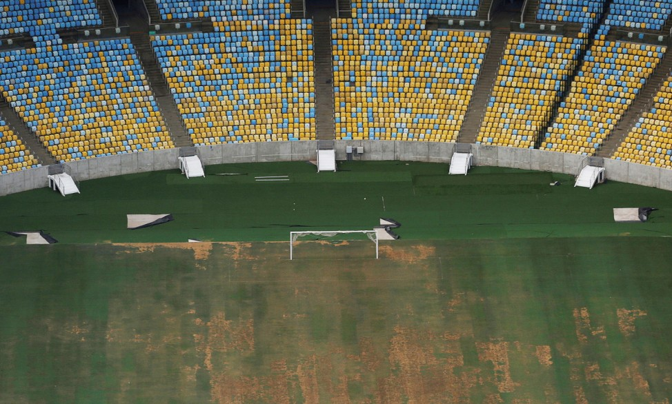 An aerial view of Maracana Stadium shows the turf being dry, worn and filled with ruts and holes, in Rio de Janeiro