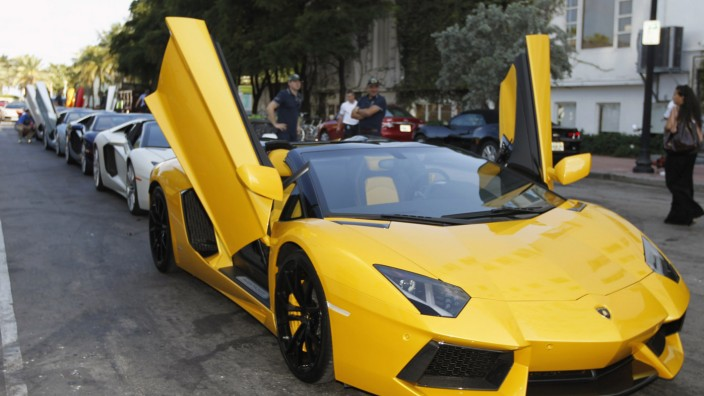 A Lamborghini Aventador LP 700-4 Roadster waits for a parade to begin before a high-speed demonstration to mark the automaker's 50th anniversary in Miami Beach, Florida