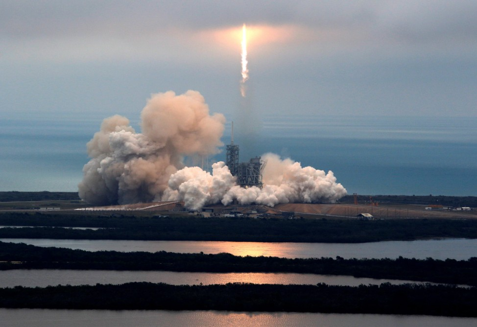 A SpaceX Falcon 9 rocket disappears into clouds after it lifted off on a supply mission to the International Space Station from historic launch pad 39A at the Kennedy Space Center in Cape Canaveral