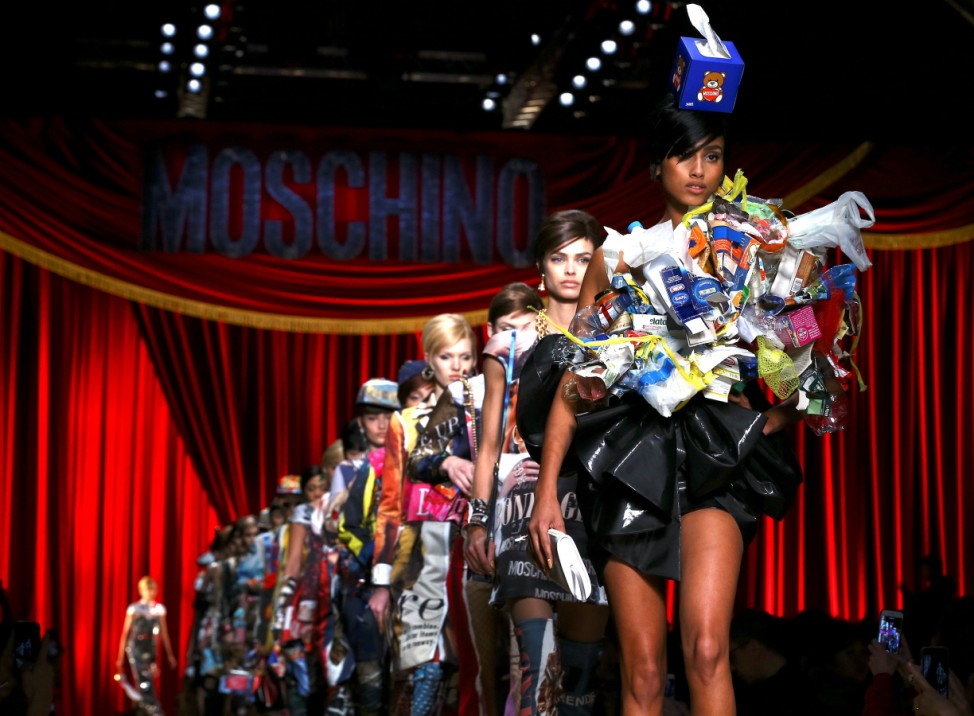 Models parade at the end of Moschino's Autumn/Winter 2017 women's collection during Milan Fashion Week in Milan
