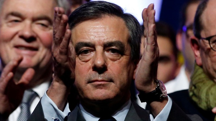 FILE PHOTO: Francois Fillon, a former French prime minister, member of The Republicans political party and 2017 presidential candidate of the French centre-right, attends a political rally in Chasseneuil-du-Poitou