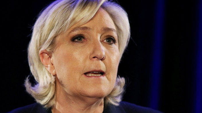 Marine Le Pen, French National Front (FN) political party leader and candidate for the French 2017 presidential election, attends a news conference in Paris