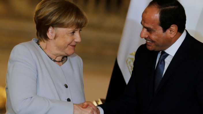 Egypt's President Abdel Fattah al-Sisi and German Chancellor Angela Merkel shake hands following a news conference at the El-Thadiya presidential palace in Cairo