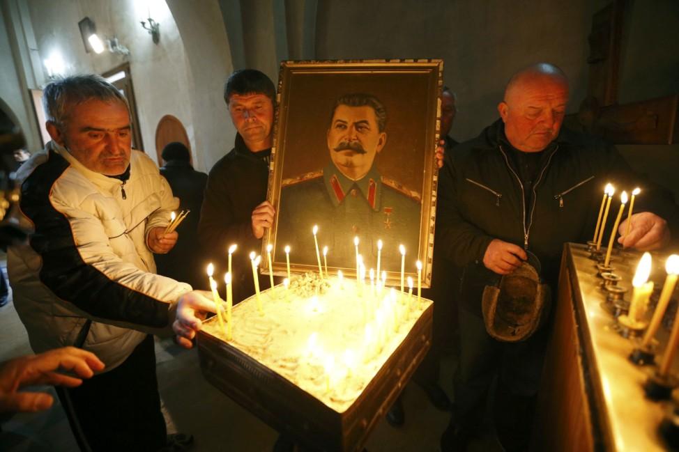 People mark the anniversary of Soviet leader Joseph Stalin's death in Gori