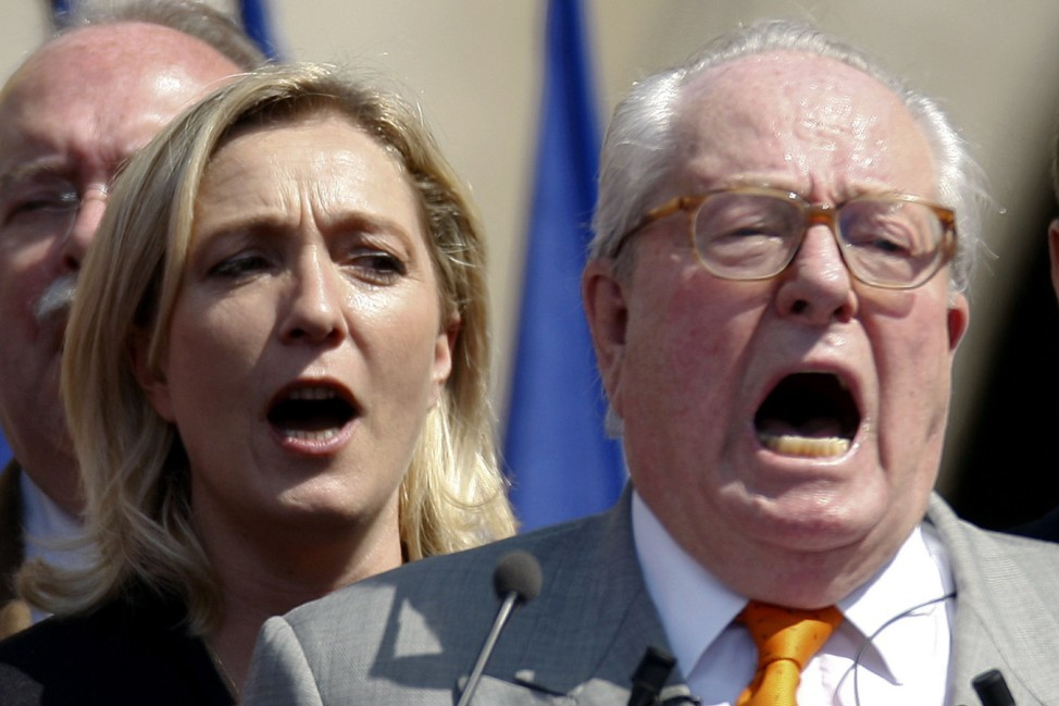 France's far-right leader Jean-Marie le Pen and his daughter Marine sing their national anthem during the National Front's annual May Day rally in Paris