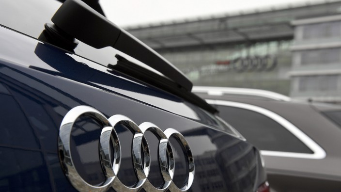 Audi cars are parked in front of the company's headquarters in Ingolstadt
