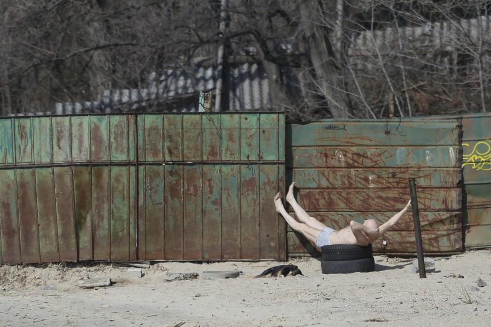A man sunbathes in Kiev