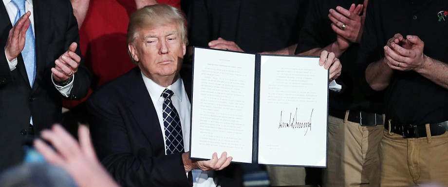 U.S. President Trump displays executive order on 'energy independence' during event at EPA headquarters in Washington