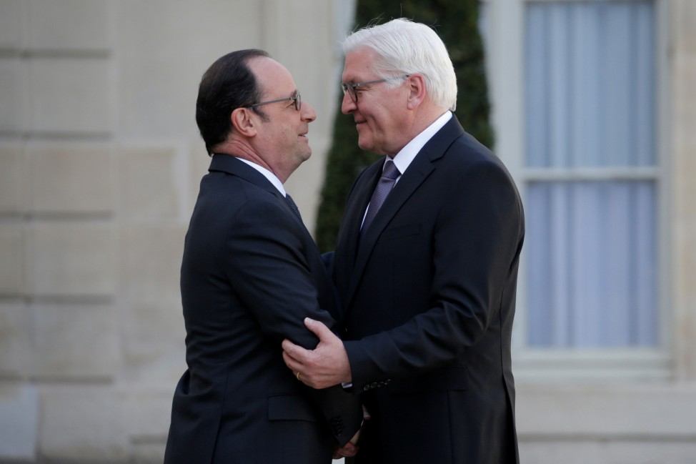 French President Francois Hollande greets German President Frank-Walter Steinmeier as he arrives at the Elysee Palace in Paris