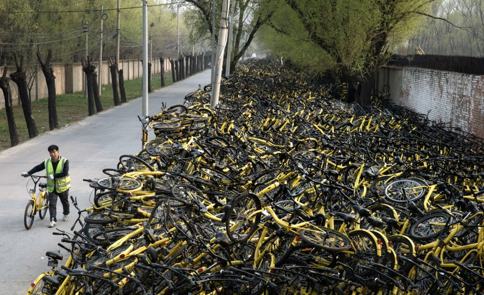 Beijing's Bike Share Boom Creates Refuge for Battered Bicycles