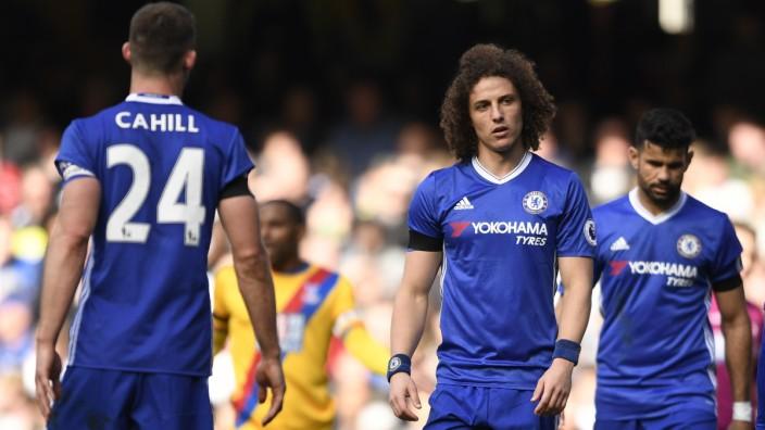 Chelsea's David Luiz looks dejected