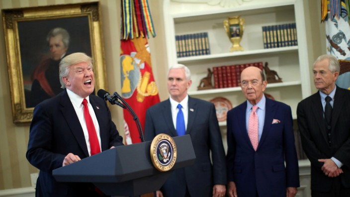 U.S. President Donald Trump speaks during a signing ceremony of executive orders on trade, accompanied by Vice President Mike Pence and U.S. Commerce Secretary Wilbur Ross at the Oval Office of the White House in Washington, U.S.