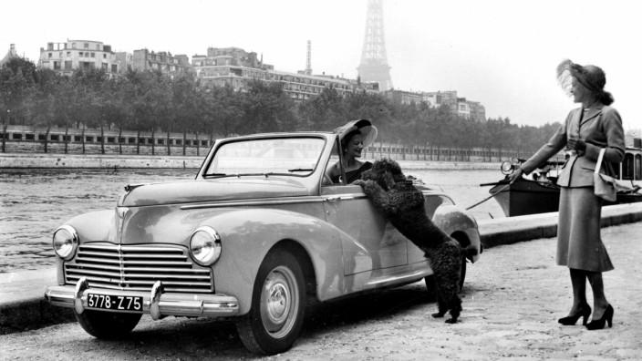 Paris, Car show. Model 203 Peugeot. Convertible, 2