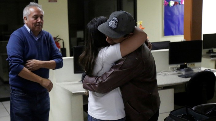 Two journalists for El Norte newspaper embrace each other after the paper announced its closure due to what it says is a situation of violence against journalists in Ciudad Juarez