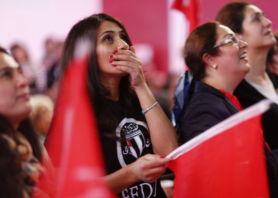 People of the Turkish community living in Germany react after first news bulletins on the outcome of Turkey's referendum on the constitution in Berlin