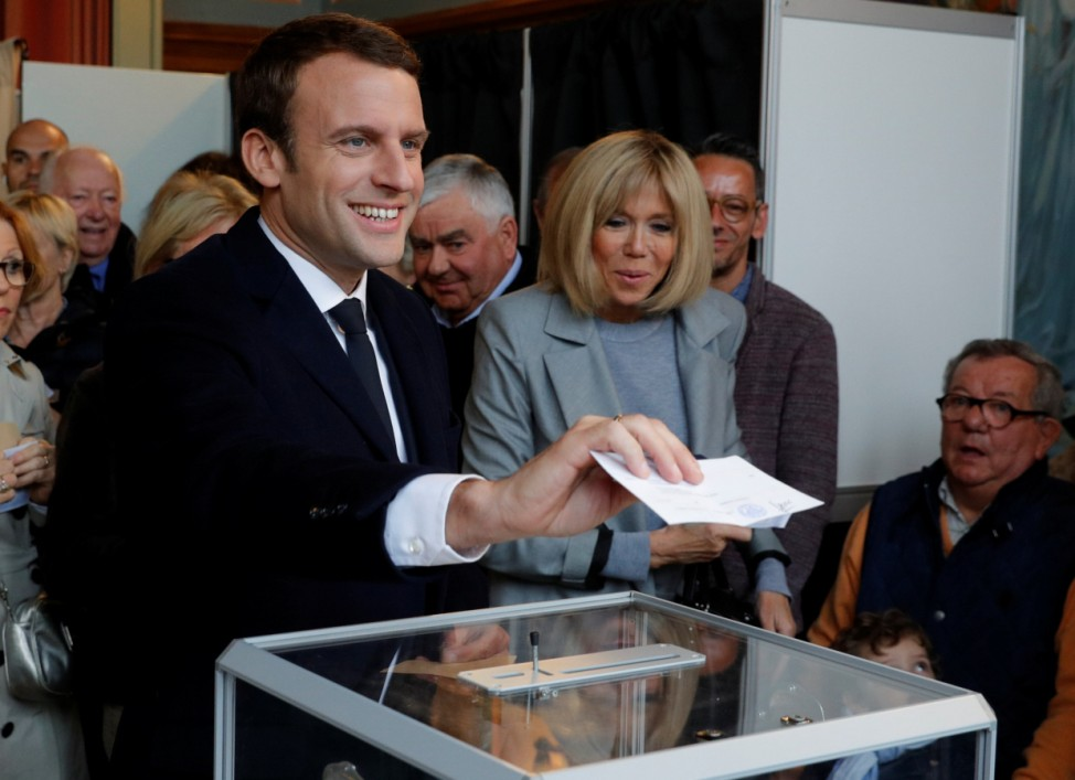 Emmanuel Macron, head of the political movement En Marche !, or Onwards !, and candidate for the 2017 French presidential election, casts his ballot in the first round of 2017 French presidential election at a polling station in Le Touquet