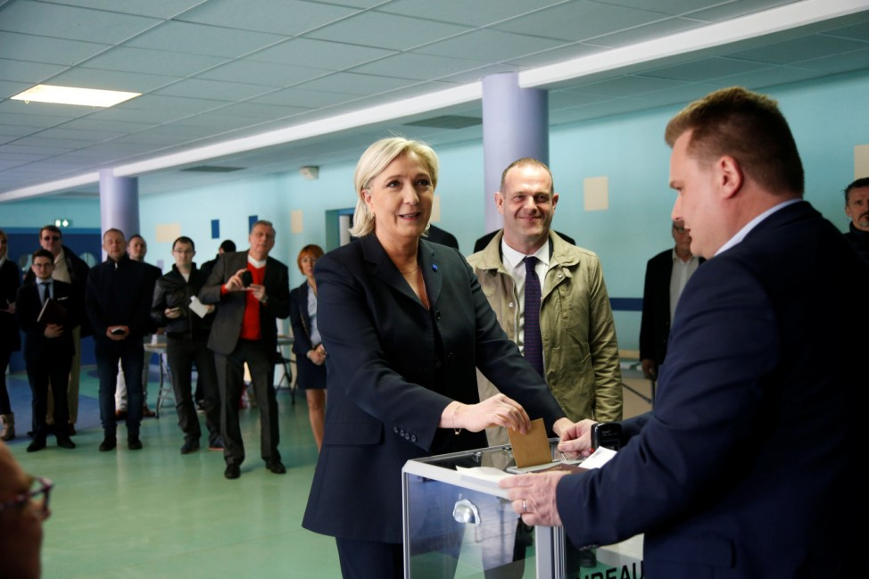 Marine Le Pen, French National Front (FN) political party leader and candidate for French 2017 presidential election, casts her ballot in the first round of 2017 French presidential election at a polling station in Henin-Beaumont