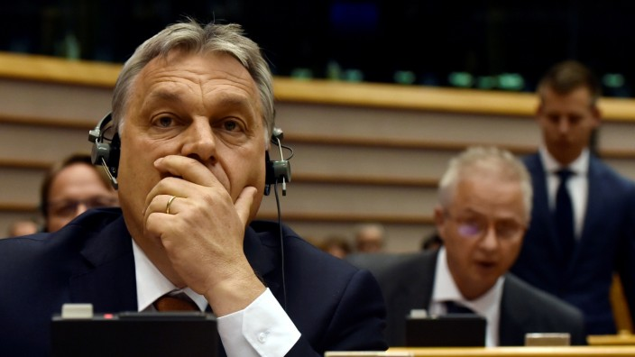 Hungary's PM Orban reacts during a plenary session at the EP in Brussels
