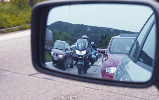 Stau auf der Autobahn im Rueckspiegel traffic jam on a highway BLWS244321