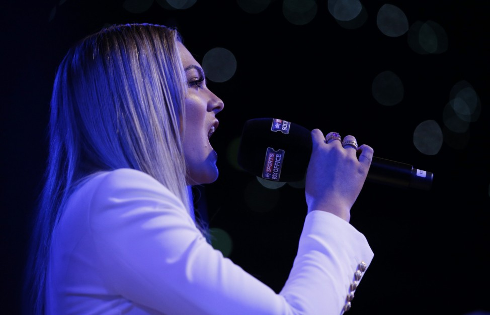 Louisa Johnson sings the British national anthem before the fight