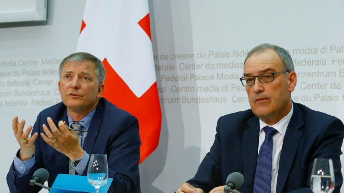 Switzerland's Defence Minister Parmelin and Swiss Federal Intelligence Service (NDB) director Seiler attend a news conference in Bern