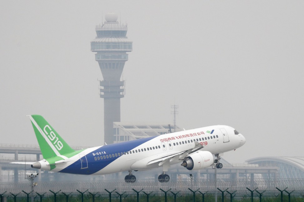 A Chinese C919 passenger jet takes off on its first flight at Pudong International Airport in Shanghai
