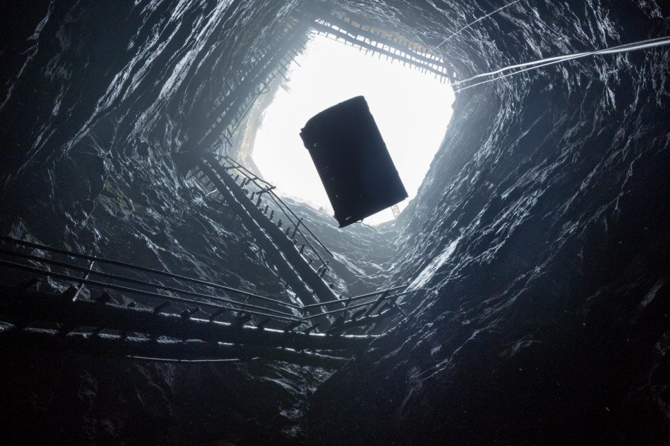 Coal is lifted out of a mine shaft two tons at a time.