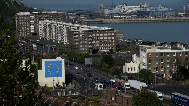 An artwork attributed to street artist Banksy, depicting a workman chipping away at one of the 12 stars on the flag  of the European Union, is seen on a wall in the ferry  port of Dover