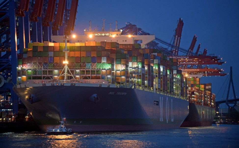 Mol Triumph, the world's largest container ship, arrives at a loading terminal in the harbour of Hamburg