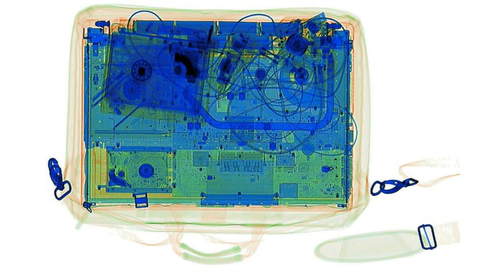 An illustration picture shows a laptop on the screen of an X-ray security scanner