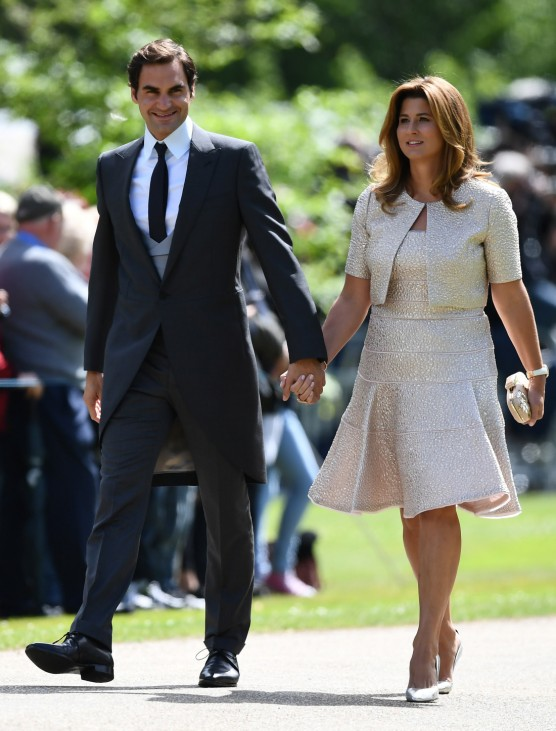 Swiss tennis player Roger Federer and his wife Mirka attend the wedding of Pippa Middleton and James Matthews at St Mark's Church in Englefield, west of London