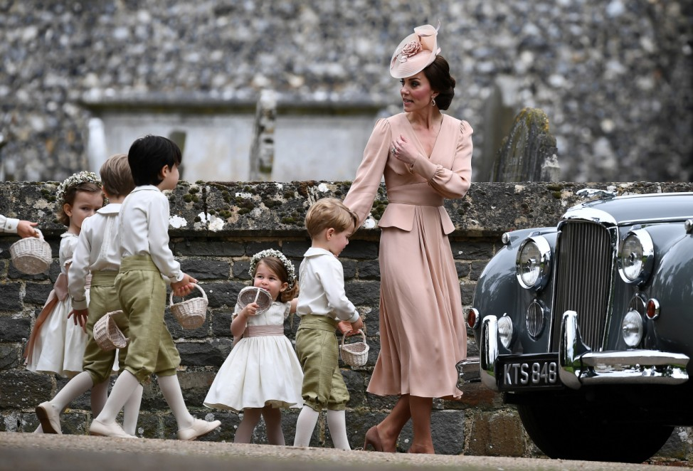 Britain's Catherine, Duchess of Cambridge walks with the flower boys and girls, including Prince George and Princess Charlotte after the wedding of Pippa Middleton and James Matthews at St Mark's Church in Englefield,