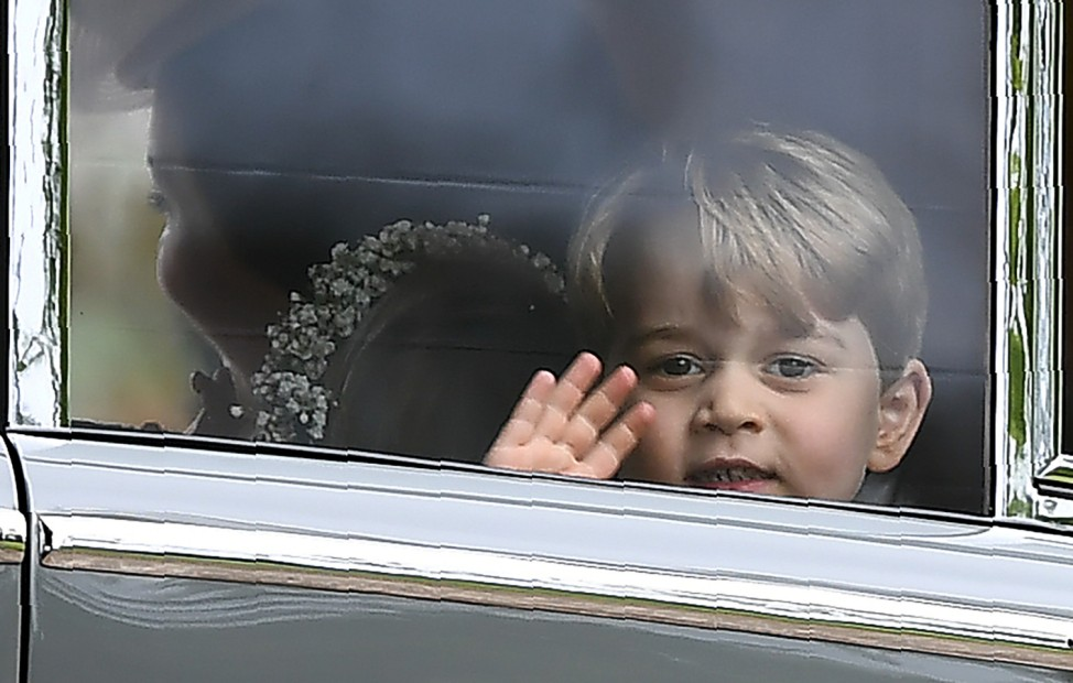 Britain's Prince George waves as he leaves in a car after attending the wedding of his aunt, Pippa Middleton, to James Matthews at St Mark's Church in Englefield