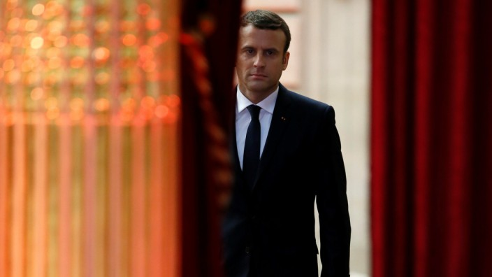 French President Emmanuel Macron arrives to deliver a speech during his inauguration at the handover ceremony at the Elysee Palace in Paris