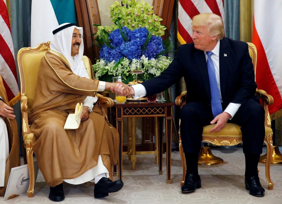 Emir of Kuwait Sabah Al-Ahmad Al-Jaber Al-Sabah shakes hands with U.S. President Donald Trump during their meeting in Riyadh